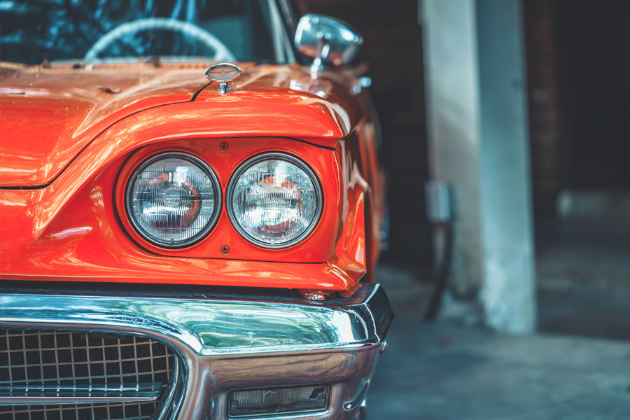 Collector Auto Insurance - Classic Red Car in a Garage