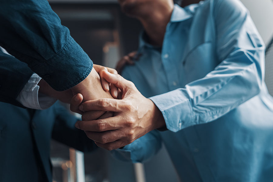 About Our Agency - Two Businessmen Shaking Hands in the Office